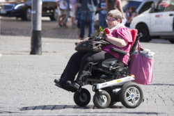 Woman with little car (wheelchair)