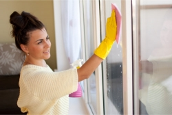 pretty woman cleaning a window